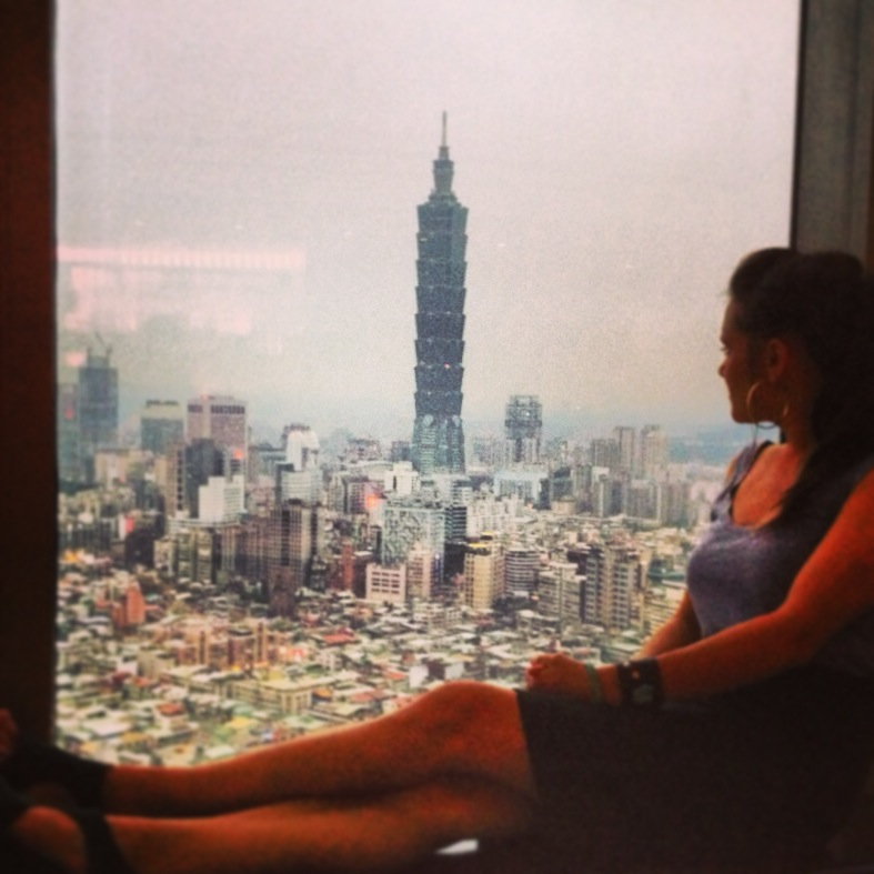 BGL's Teacher Courtney with Taipei 101.