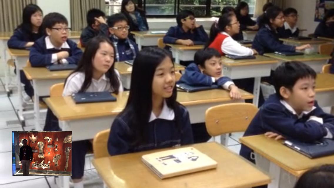 Students listen to NHM's Teacher Jessie introduce specific dinosaur bones.