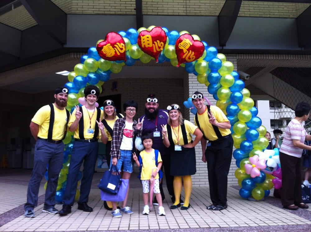 Elementary teachers in Taipei dressed like Minions... and took pictures with each student as they arrived!