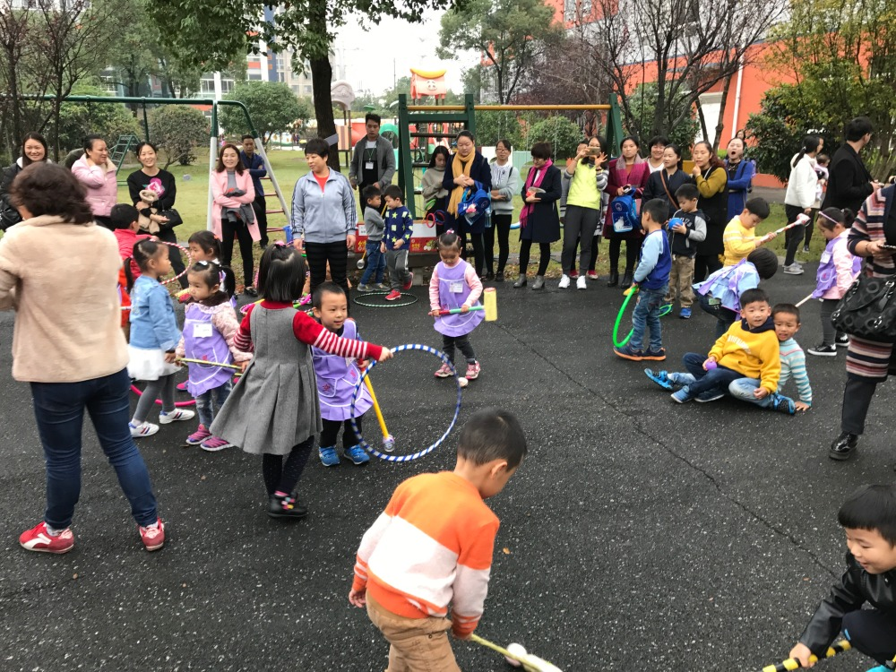 Parents, teachers and students play in XingKong's plentiful play-yard.