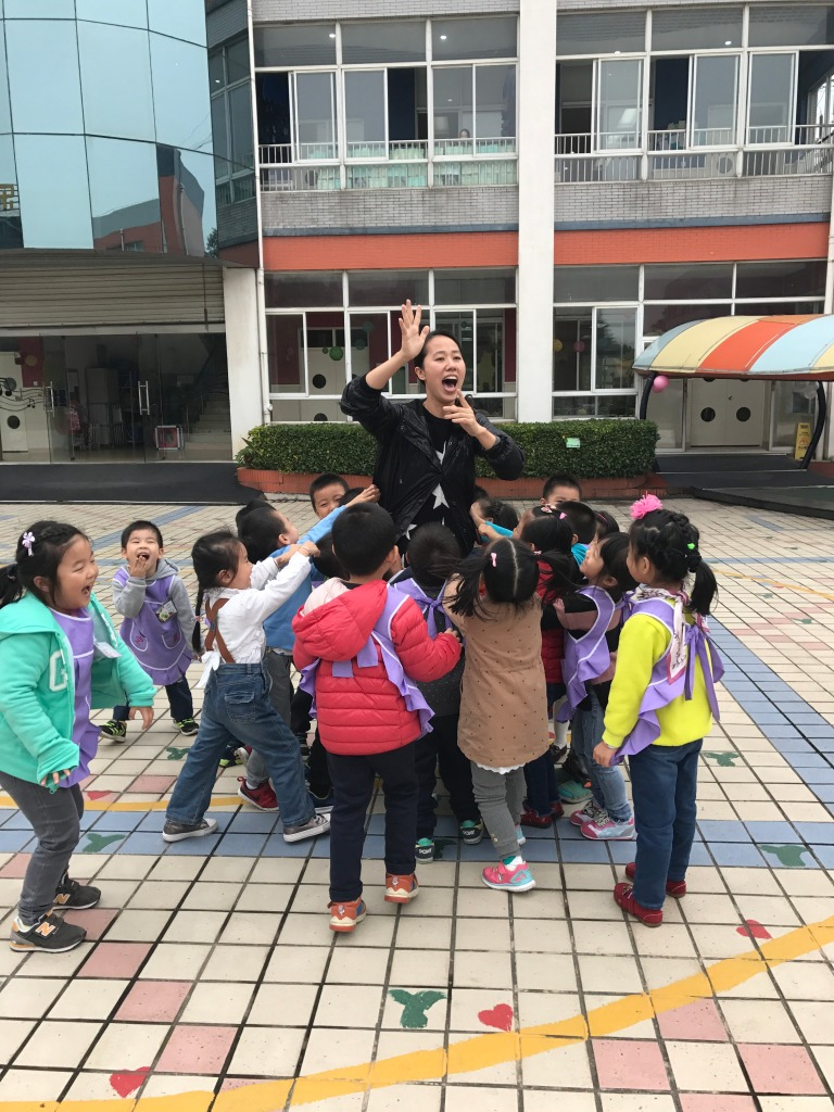 Chinese local teacher, Sienna, rallies her troops while playing a game outside.